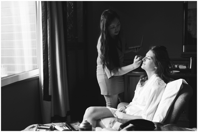 black and white image of a Bride getting prepared for her wedding.