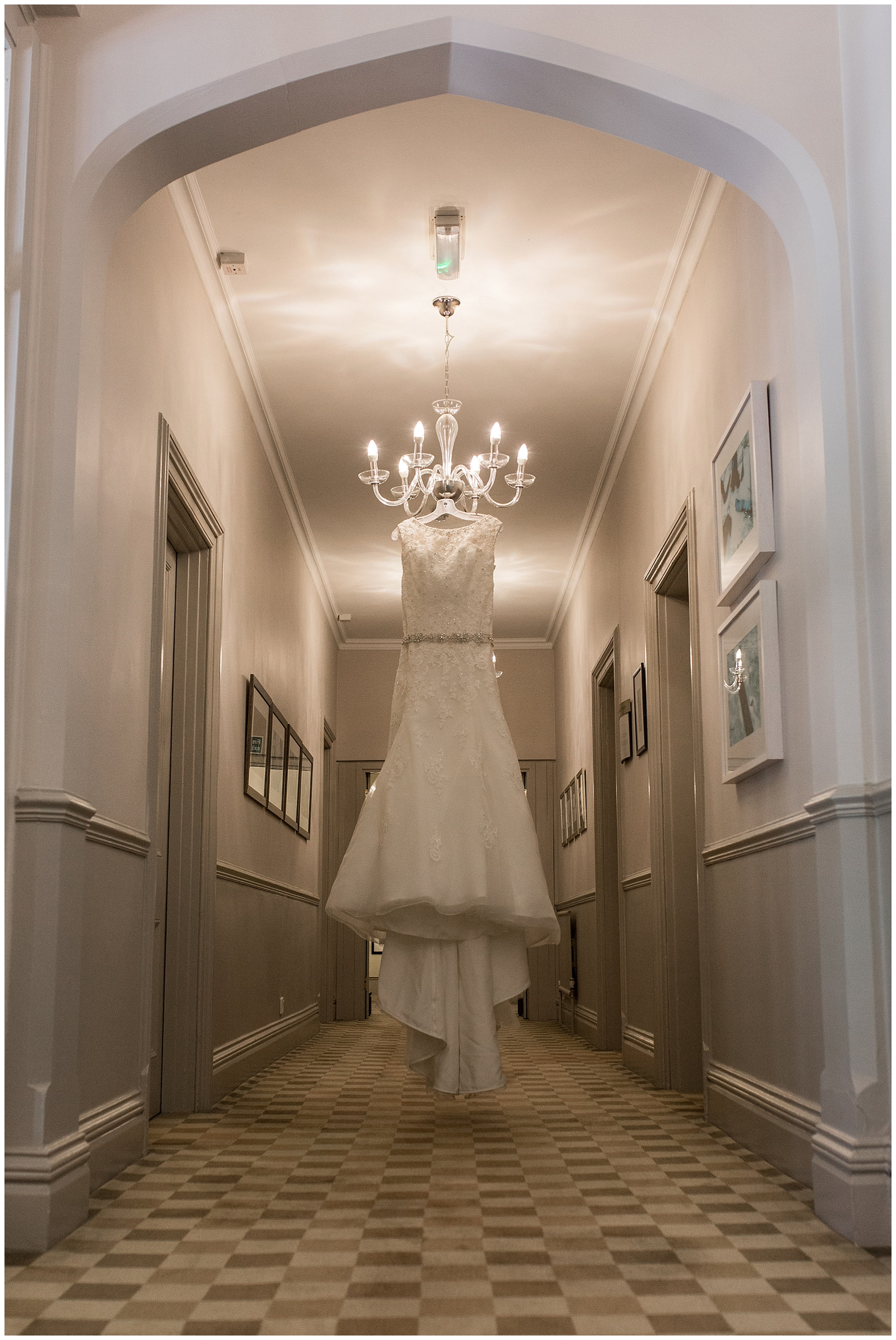 wedding dress hanging from lights in a corridor