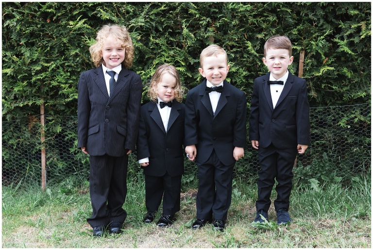 Little boys dressed up in suits for a wedding