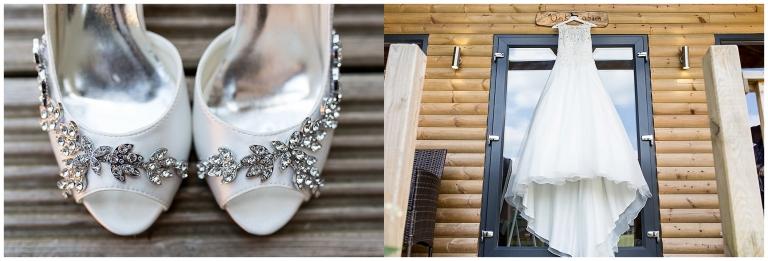 White bridal dress hanging on display, white bridal shoes